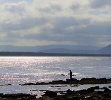Fisherman on Rocks by jimrac