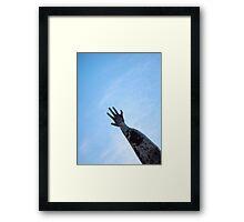 rising hand Framed Print