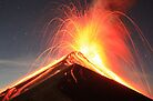 Fuego Erupts on a Moonlit Night by Kevin Sebold