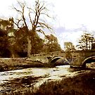 The Packhorse Brige at Haddon Hall in Derbyshire by Dennis Melling