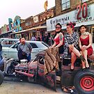 Austin Girls wave at passing hot rods on South Congress by Jack McCabe