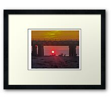 ENJOYING THE SUNSET ATHE BEACH Framed Print