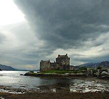 Dark clouds above Eilean Donan Castle - Scotland by Arie Koene