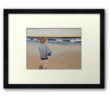 Boy on the beach Framed Print