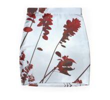 Red leaves in sky Mini Skirt