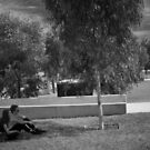 Couple sitting in the shade by John Violet