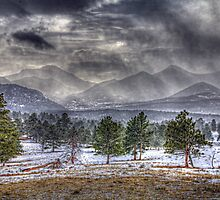 Rocky Mountains - Spring Storm by Roger Passman