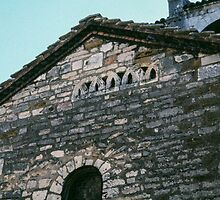 Reused stone work in porch of St Nicholas Beaune France 198404290016 by Fred Mitchell