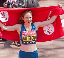 Amy Whitehead after crossing the finish line of the London Marathon by Keith Larby