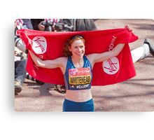 Amy Whitehead after crossing the finish line of the London Marathon Canvas Print