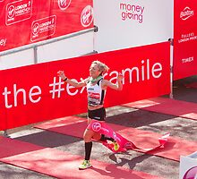 Amy Whitehead crossing the finish line of the London Marathon by Keith Larby