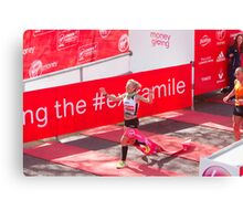 Amy Whitehead crossing the finish line of the London Marathon Canvas Print