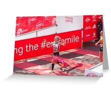 Amy Whitehead crossing the finish line of the London Marathon Greeting Card