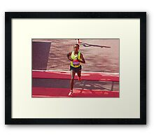 Kebede crosses the finish line of the London Marathon  Framed Print