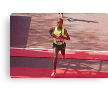 Kebede crosses the finish line of the London Marathon  Canvas Print