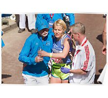 A runner is helped after crossing the finish line of the London Marathon Poster