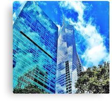 two reflect on a building Canvas Print