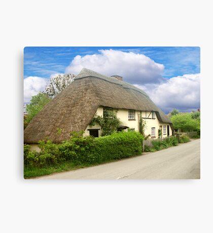 A Quaint Little Thatched Cottage Canvas Print