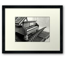 Piano and quill Framed Print