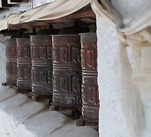 Buddhist prayer wheels in Nepal by Kelly Eaton