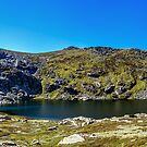 A Mountain Lake by Mark  Lucey