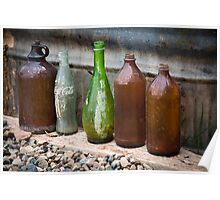 Bottles on the ground Poster