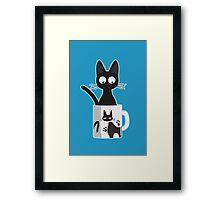 Cat In A Mug Framed Print