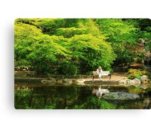 Reading At The Pond Canvas Print