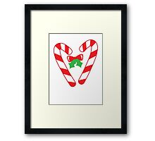 Christmas candy canes with a bow Framed Print