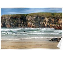 surfers competition near cliffs Poster