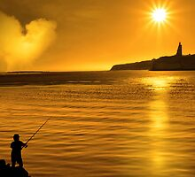 silhouette of father and son loving fishing in Ireland by morrbyte
