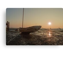 Boat at low tide at sunset Canvas Print