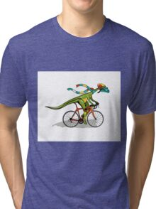 Illustration of an Anabisetia dinosaur riding a bicycle. Tri-blend T-Shirt