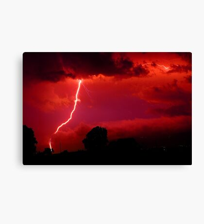 Lightning in red sky Canvas Print