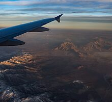 Loving the Window Seat - Sunrise Flight Over the High Mojave Desert  by Georgia Mizuleva