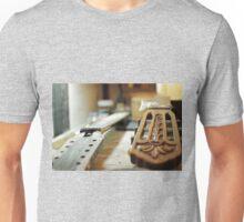 Guitar grips repairing shallow dof Unisex T-Shirt