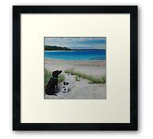 Dogs resting on beach Framed Print