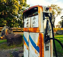 Old rustic pump at an abandoned fuel station by Rob D