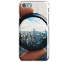 Man holding a lens over Manhattan iPhone Case/Skin