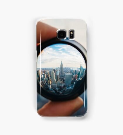 Man holding a lens over Manhattan Samsung Galaxy Case/Skin