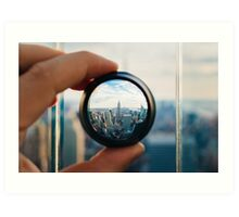 Man holding a lens over Manhattan Art Print