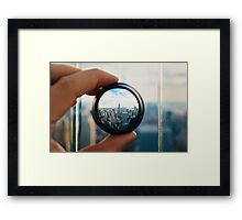 Man holding a lens over Manhattan Framed Print