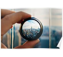 Man holding a lens over Manhattan Poster