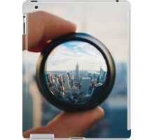 Man holding a lens over Manhattan iPad Case/Skin