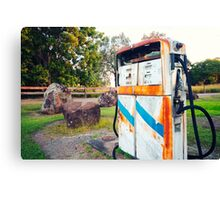 Old rustic pump at an abandoned fuel station Canvas Print