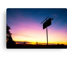 Old rustic fuel station sign as a silhouette. Canvas Print