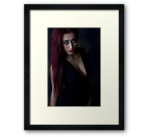 behind dark eyes Framed Print