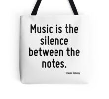 Music is the silence between the notes. Tote Bag
