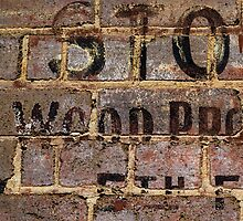 Vintage writing on brick wall  by Stanciuc