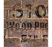 Vintage writing on brick wall  Photographic Print